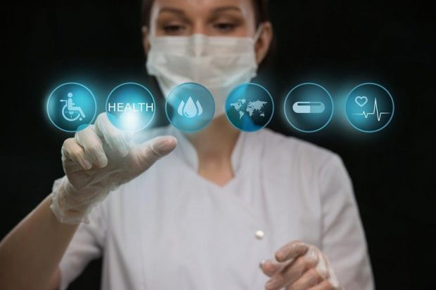 A doctor with virtual buttons on a screen